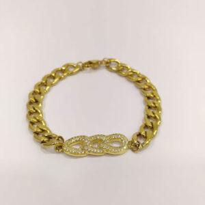 Pulseira com fio largo dourado em aço e ligador em cobre dourado com zircónias