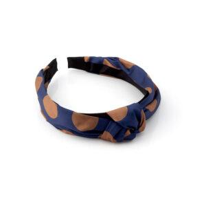 Bandolete em tecido acetinado azul marinho com bolas em cor castanha, entrelaçada em cima